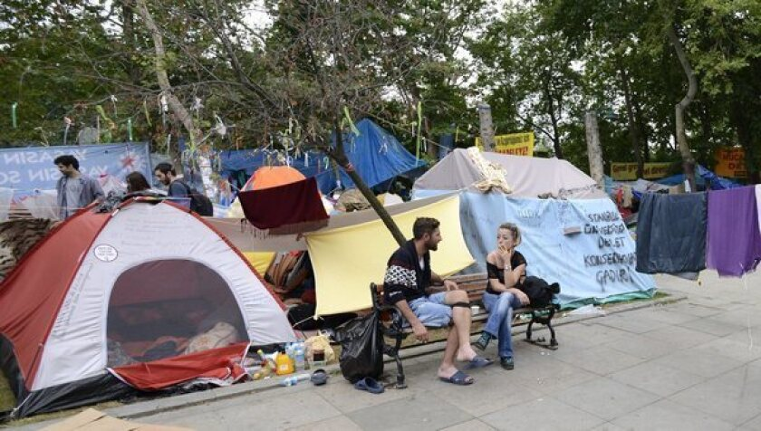 Activists chat in front of their tents Saturday at Gezi Park in Istanbul, Turkey.