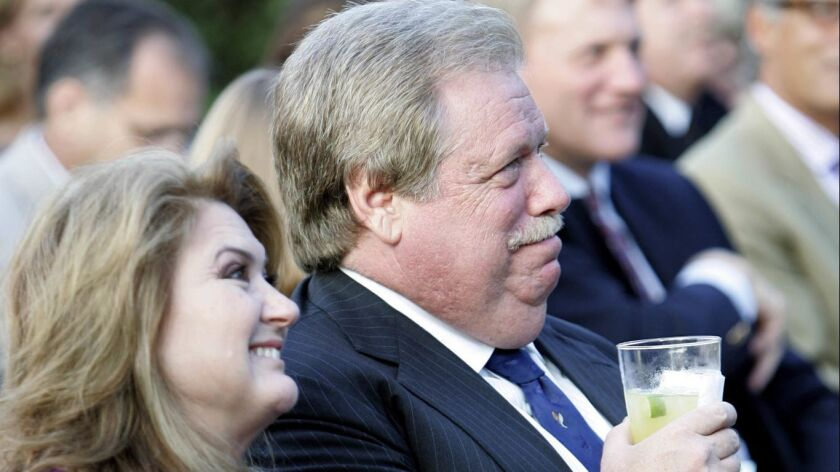 Co–hosts Robin and Elliott Broidy listen to a speaker during the fundraiser for American Ballet Thea