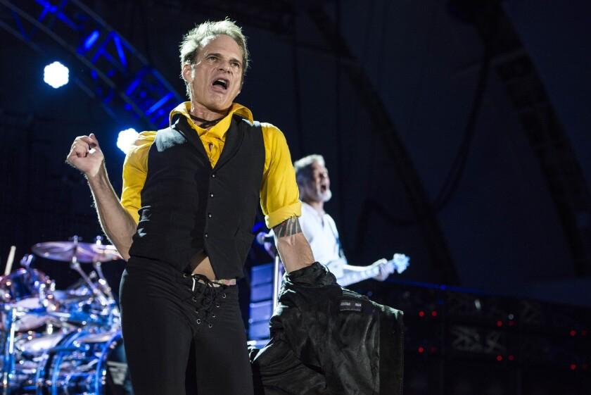 David Lee Roth, left, and Eddie Van Halen of Van Halen perform Friday night at the Hollywood Bowl in Los Angeles.