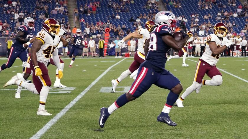 New England Patriots running back Rhamondre Stevenson (38) dashes for a 91-yard touchdown during the second half of the team's preseason NFL football game against the Washington Football Team, Thursday, Aug. 12, 2021, in Foxborough, Mass. (AP Photo/Elise Amendola)