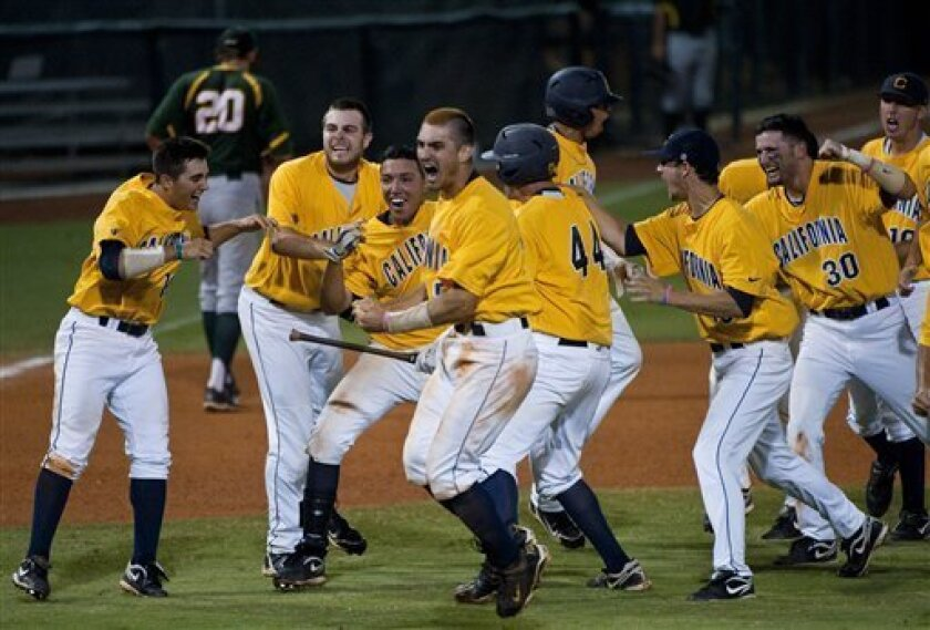 California players celebrate their win an NCAA regional college baseball game against Baylor, Monday, June 6, 2011, in Houston. California beat Baylor 9-8. (AP Photo/Dave Einsel)