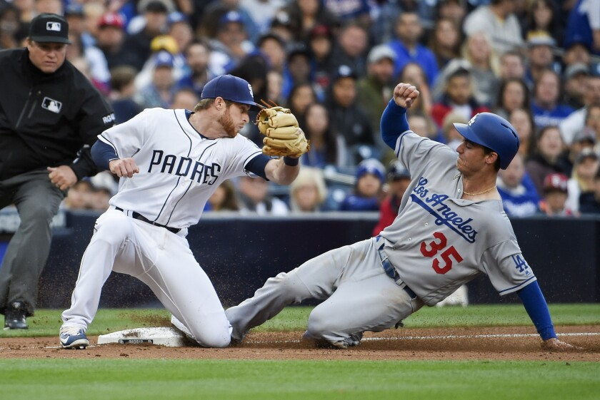 Dodgers rookie Cody Bellinger steals third base before San Diego's Cory Spangenberg can apply the ta