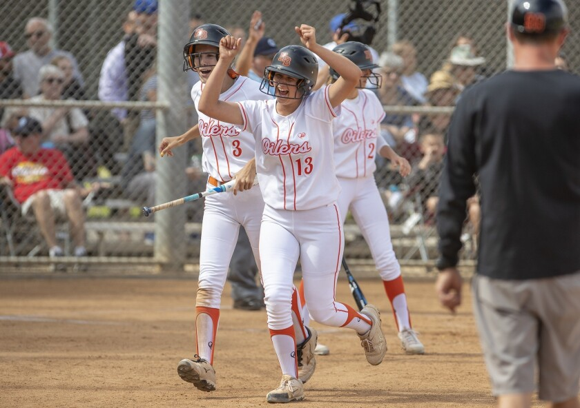 Huntington Beach's Katelyn Mangrello, left, and Ameryn Humble celebrate scoring on an error in the s