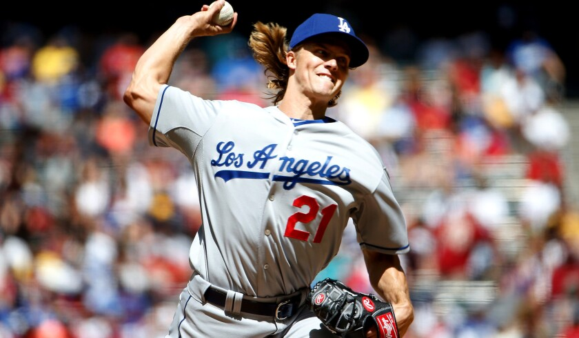 Dodgers starter Zack Greinke pitched seven shutout innings against the Diamondbacks on Sunday at Chase Field.