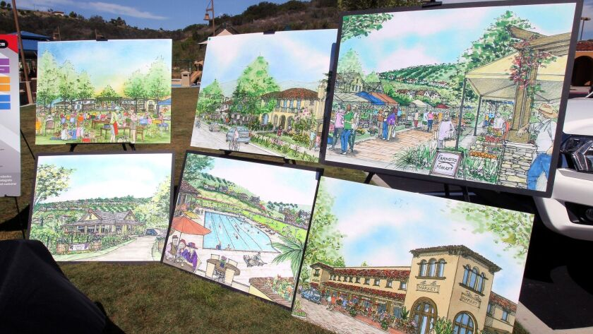 At Carlsbad's Alga Norte Park, renderings of the proposed Lilac Hills Ranch community development project were displayed.