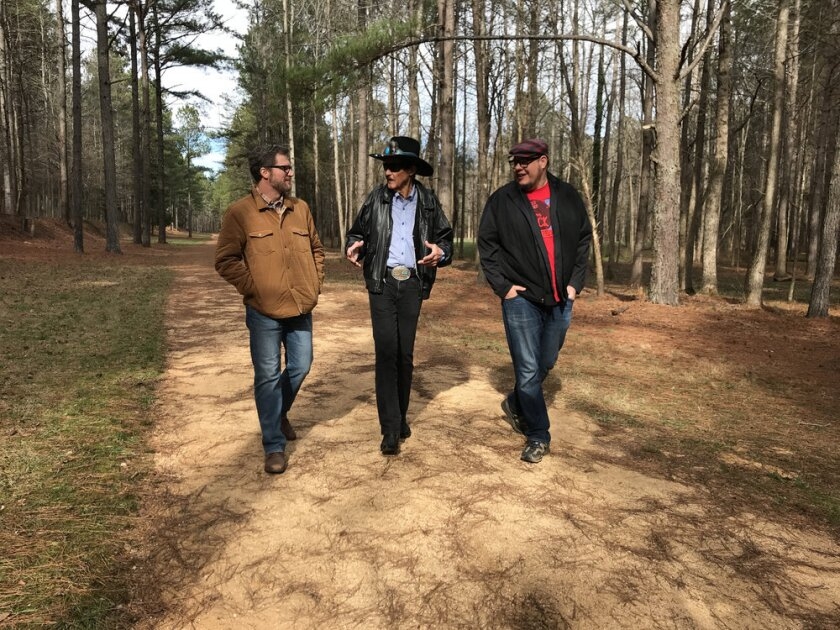 "Dale Earnhardt Jr., Richard Petty and co-host Matthew Dillner in Peacock's ""Lost Speedways."""