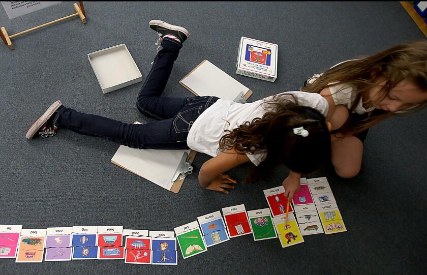 LAUSD children solving puzzles