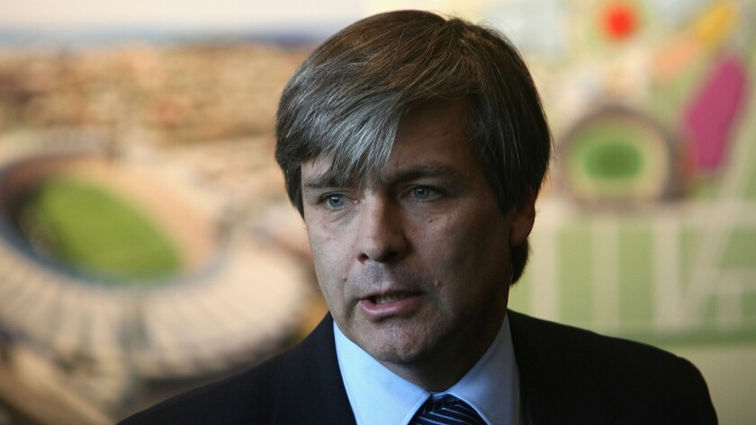 """Harold Mayne-Nicholls, the former head of the FIFA inspection team, speaks during an inspection tour in Melbourne, Australia, in July 2010. FIFA's ethics committee has banned him from """"any kind of football-related activity at national and international level"""" for seven years, but gave no reason for the decision."""