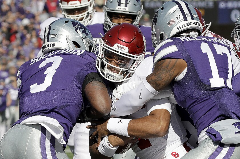 Oklahoma quarterback Jalen Hurts, center, pushes his way into the end zone for a touchdown against Kansas State on Saturday.