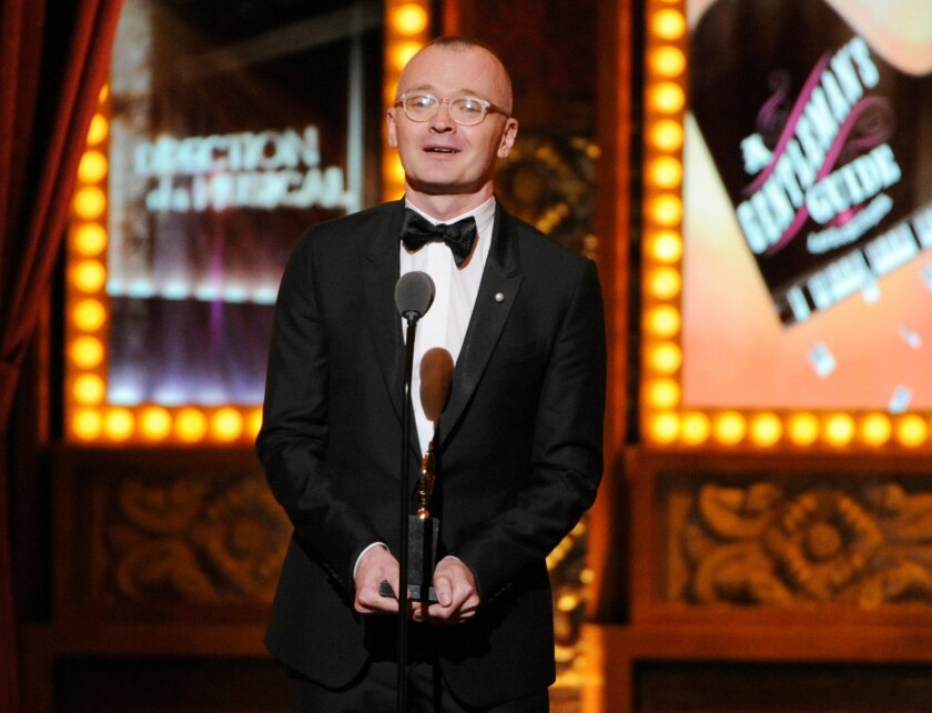 """Darko Tresnjak accepts the award for best direction of a musical for """"A Gentleman's Guide to Love & Murder"""" onstage at the 68th annual Tony Awards at Radio City Music Hall on Sunday, June 8, 2014, in New York. (Photo by Evan Agostini/Invision/AP)"""