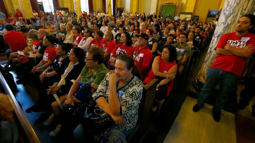 A crowd fills the Los Angeles City Council chambers in June as the Planning Commission considers imposing new regulations on Airbnb and other websites that help Angelenos rent out rooms or entire homes for short stays.