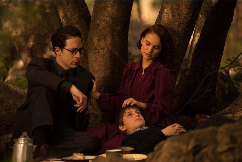 "Gilad Kahana as Arieh Oz, left, Natalie Portman as Fania Oz and Amir Tessler as Amos Oz in ""A Tale of Love and Darkness."""