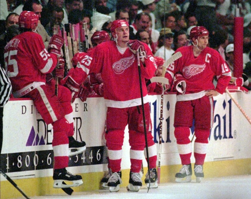 FILE - In this May 29, 1996, file photo, Detroit Red Wings' Keith Primeau (55), Darren McCarty (25) and Steve Yzerman (19) rest at the bench during a time out in the closing minutes of their 4-1 loss to the Colorado Avalanche in Game 6 of the Western Conference Finals in Denver. Despite the record-