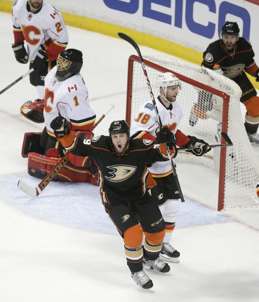 Anaheim Ducks' Matt Beleskey, center, celebrates his goal against the Calgary Flames during the first period of Game 1 in the second round of the NHL Stanley Cup hockey playoffs, Thursday, April 30, 2015, in Anaheim, Calif. (AP Photo/Jae C. Hong)