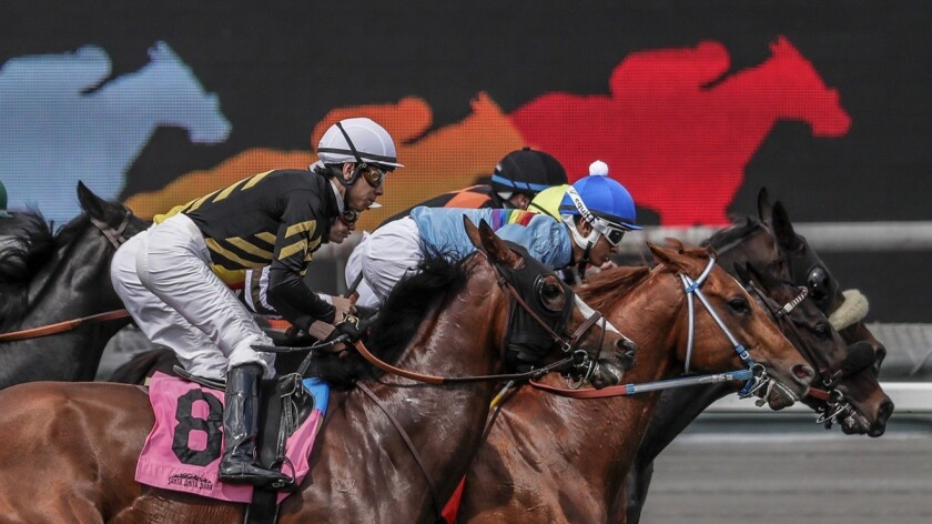 ARCADIA, CA, THURSDAY, APRIL 4, 2019 - Horses and jockeys set off in the fourth race, a 1 mile run o
