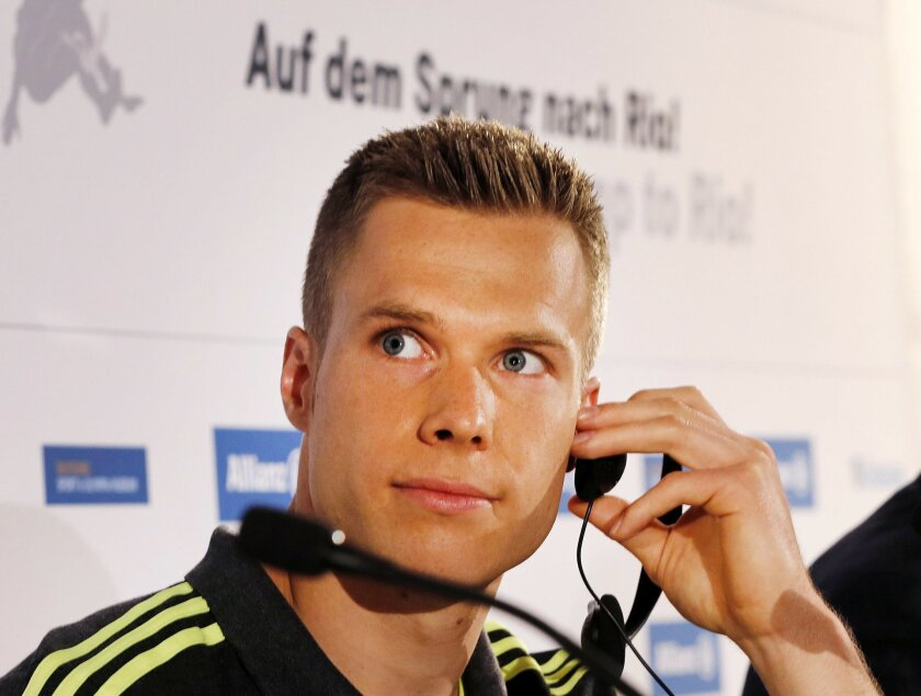 German so called blade jumper Markus Rehm attends a press conference in Cologne, Germany, Monday, May 30, 2016. Various scientists presented the outcome of an investigation if Rehm with his prosthesis has a technical advantage over able bodied athletes. (AP Photo/Michael Probst)