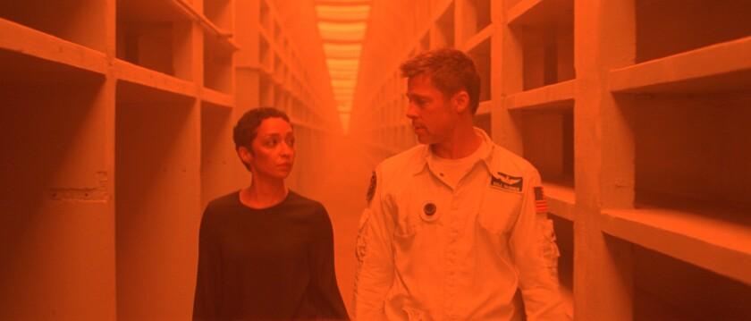 "Ruth Negga and Brad Pitt star in ""Ad Astra."""