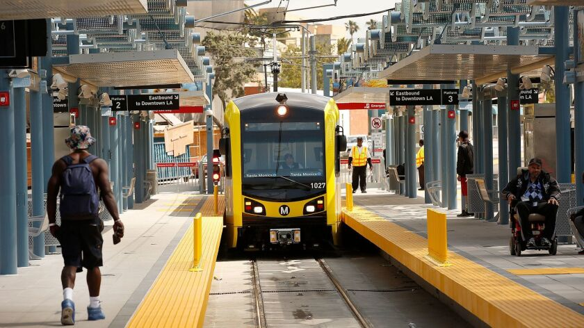 Los Angeles County voters on Tuesday approved a tax to expand its mass-transit network. Pictured here: The new Expo Line pulling into Santa Monica.