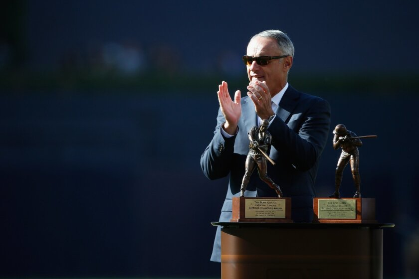 SAN DIEGO, CA - JULY 12:  Major League Baseball Commissioner Rob Manfred stands with the Tony Gwynn National League Batting Champion Award and the Rod Carew American League Batting Champion Award prior to the 87th Annual MLB All-Star Game at PETCO Park on July 12, 2016 in San Diego, California.  (P