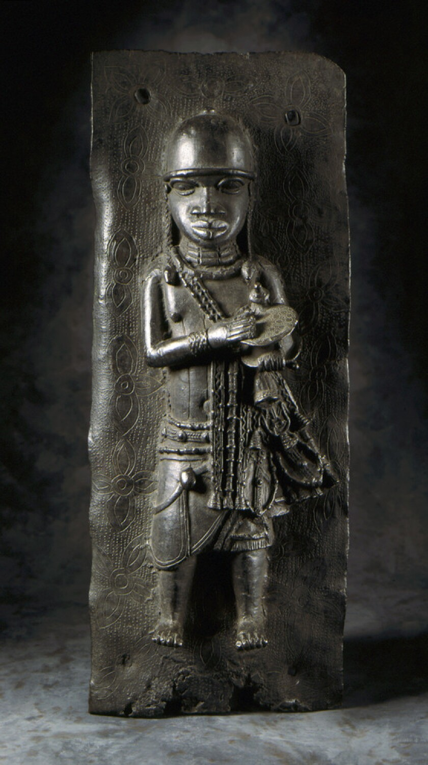 A figure of a person in relief on a block