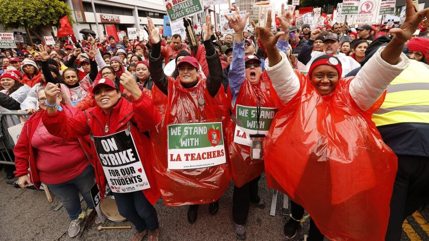 Teachers and supporters cheer during a rally in downtown Los Angeles on Jan. 15.