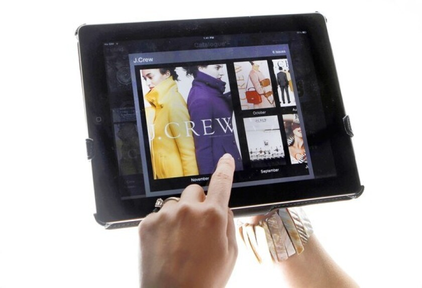 Online shoppers can flip through catalog pages digitally using an iPad.