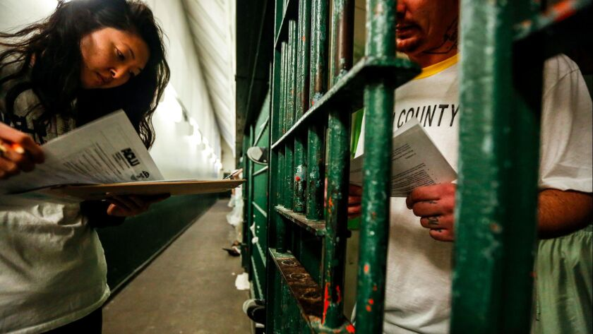 Esther Lim of the ACLU of Southern California looks over forms at Men's Central Jail as part of an initiative to educate inmates about voting rights.