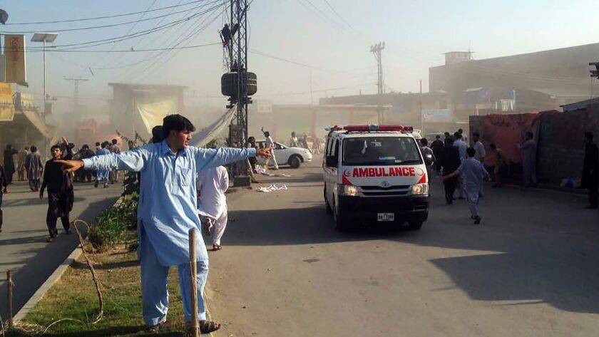 An ambulance transports victims after a twin blasts at a market in the Pakistani city of Parachinar