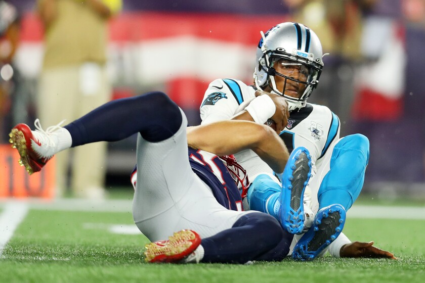 Carolina Panthers' Cam Newton is sacked by New England Patriots' Kyle Van Noy during a preseason game on Thursday in Foxborough, Mass.