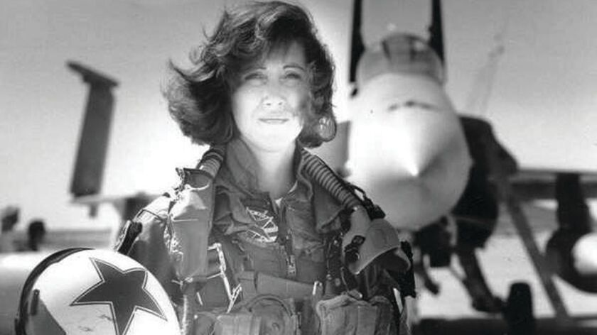 Tammie Jo Shults, shown in the early 1990s, was one of the Navy's first female fighter pilots. She went on to work for Southwest Airlines.