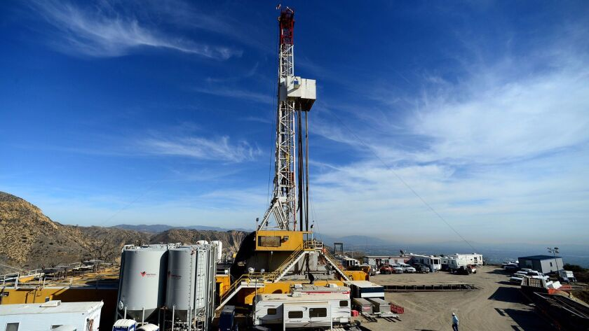 In this December 2015 file photo, crews work on stopping a gas leak at a relief well at the Aliso Canyon facility. Scientists say a gas leak that forced thousands of people from their Los Angeles homes was the largest reported release of climate-changing methane in U.S. history.