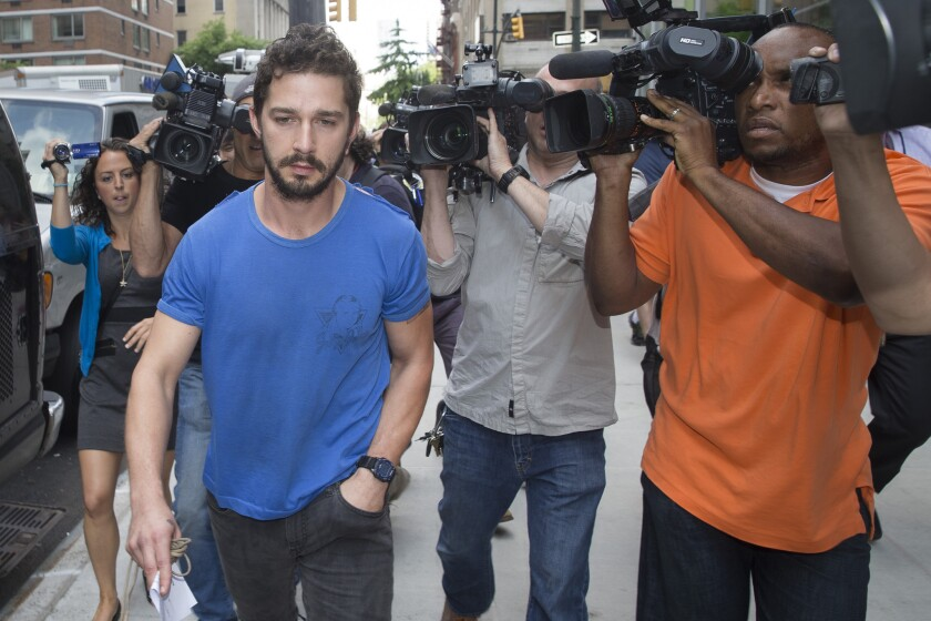 Shia LaBeouf is dogged by members of the media as he walks to his New York City hotel room after leaving court June 27. The actor is now seeking treatment in L.A. for alcohol addiction.