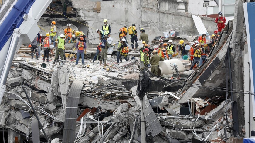 MEXICO CITY, -- SUNDAY, SEPTEMBER 24, 2017: The search continues for victims buried under the rubbl