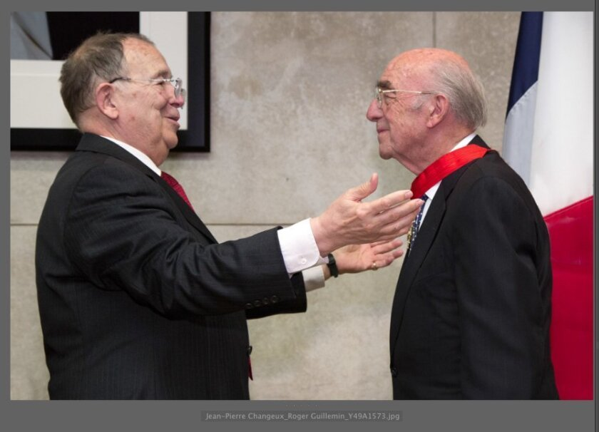 Jean-Pierre Changeux (left) awards Roger Guillemin with the Commander rank in France's Legion of Honor.