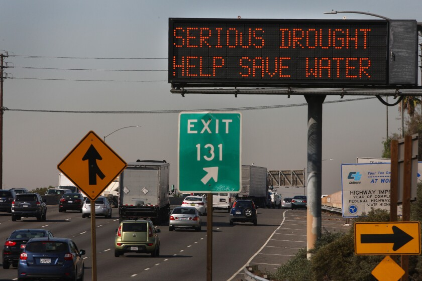 "Caltrans is urging residents across the state to conserve water by posting the message ""Serious drought. Help save water"" on message boards along the freeways."
