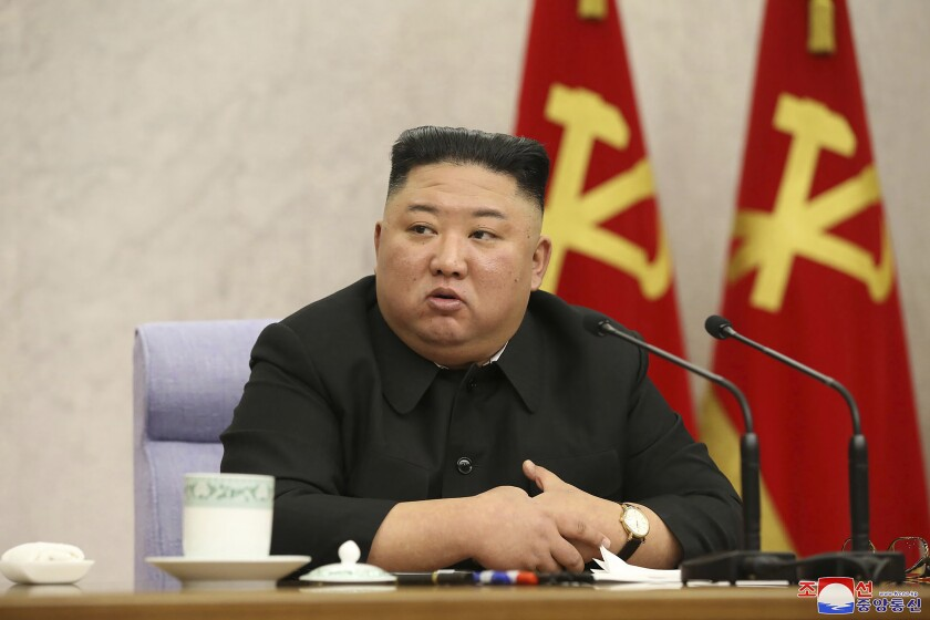 """In this photo provided by the North Korean government, North Korean leader Kim Jong Un attends at a meeting of Central Committee of Worker's Party of Korea in Pyongyang, North Korean, Wednesday, Feb. 10, 2021. Independent journalists were not given access to cover the event depicted in this image distributed by the North Korean government. The content of this image is as provided and cannot be independently verified. Korean language watermark on image as provided by source reads: """"KCNA"""" which is the abbreviation for Korean Central News Agency. (Korean Central News Agency/Korea News Service via AP)"""