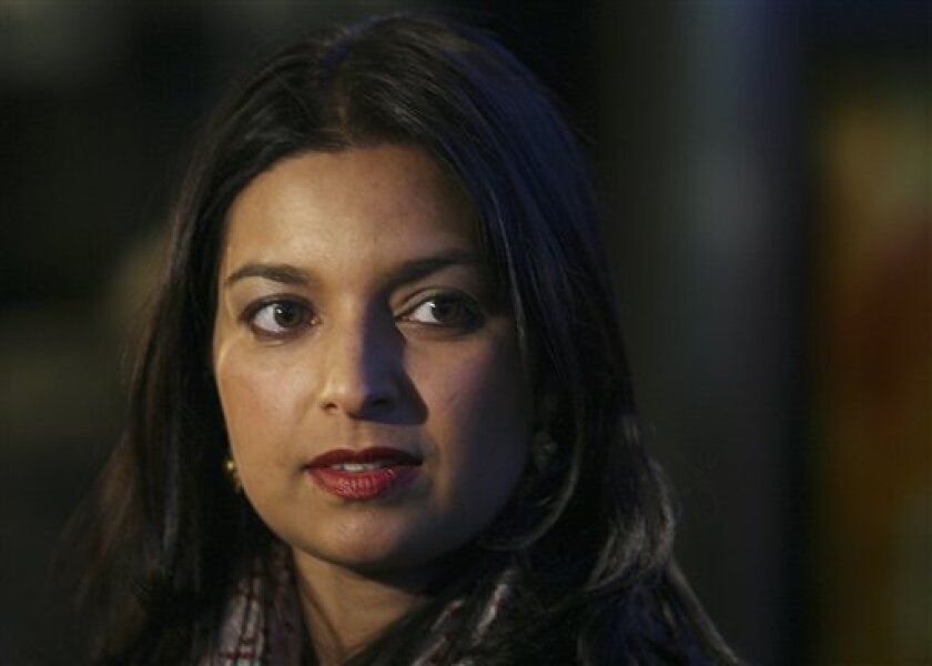 "FILE - This is a Tuesday, March 6, 2007 file photo of writer Jhumpa Lahiri as she arrives to the Fox Searchlight premiere of the movie ""Namesake"" In New York. Pulitzer Prize-winner Jhumpa Lahiri and Irish novelist Colm Toibin are among six finalists for the prestigious Booker Prize for fiction it was announced Tuesday Sept. 10, 2013. (AP Photo/Dima Gavrysh, File)"