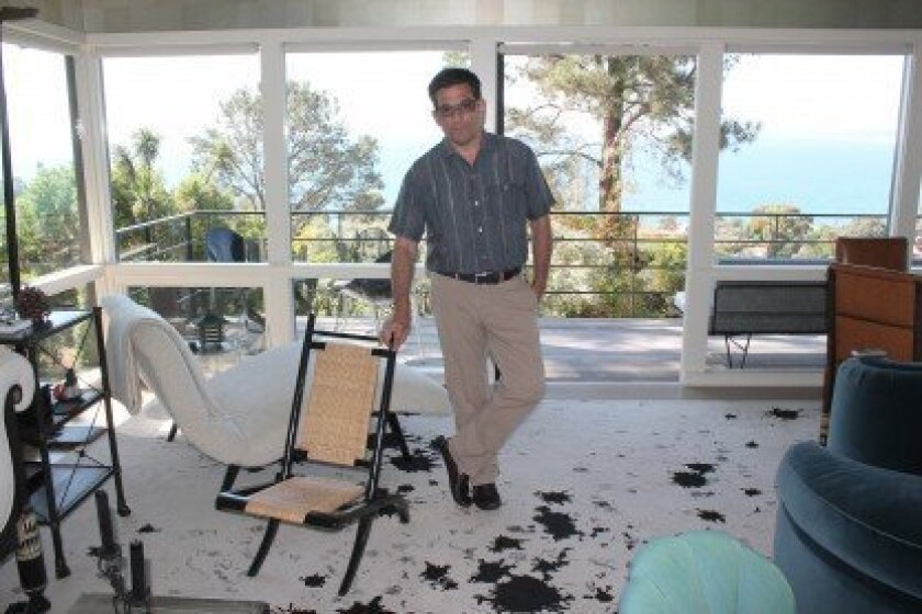 The living room of William Georgis' La Jolla vacation home features a rug woven from a pattern he created by standing on a ladder and dropping ink onto Japanese paper — something he jests is 'a product of my twisted mind.'