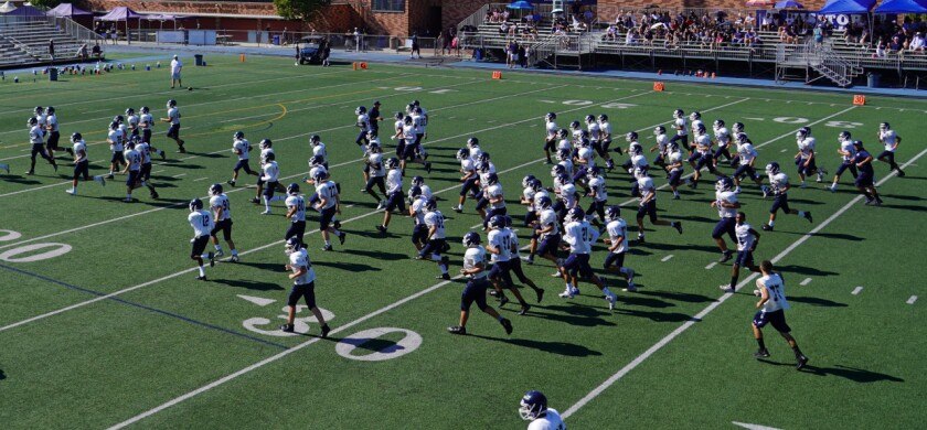 Members of the Loyola freshman football team practice earlier this season.