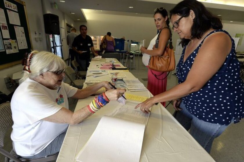 The U.S. Senate passed a bipartisan immigration bill that has moved to the GOP-controlled House. Above: Latino voters Ana-Maria Baneulos, middle, and her mother Debbie Burruel, right, prepare to vote at a polling station in the San Fernando Valley.