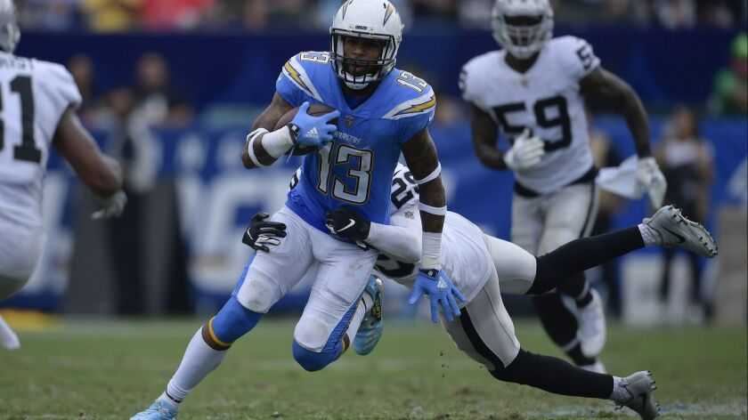 Los Angeles Chargers wide receiver Keenan Allen carries as Oakland Raiders defensive back Leon Hall