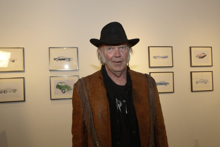 Neil Young with his watercolors and prints of iconic automobiles that he grew up with. His show is at the Robert Berman Gallery, Bergamont Station Arts Center in Santa Monica.