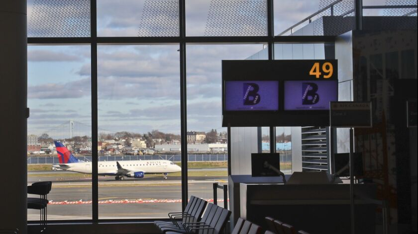 An airliner is viewed from inside the new Terminal B at LaGuardia Airport after its opening by New Y