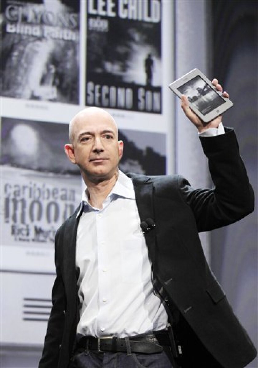 Jeff Bezos, Chairman and CEO of Amazon.com, introduces the Kindle Touch 3G at a news conference, Wednesday, Sept. 28, 2011 in New York. (AP Photo/Mark Lennihan)