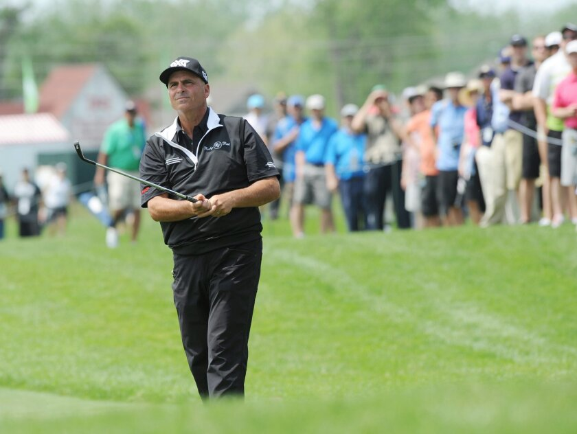 Rocco Mediate watches a shot on the 14th hole during the first round of the Senior PGA Championship golf tournament at Harbor Shores in Benton Harbor, Mich. (Don CampbellThe Herald-Palladium via AP)