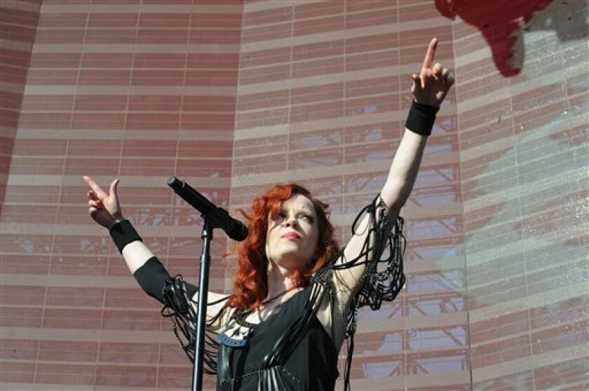 "FILE - In this May 5, 2012 file photo, Shirley Manson of Garbage performs live at the KROQ Weenie Roast Y Fiesta, at The Verizon Ampitheater in Irvine, Calif. Garbage released their first album in seven years, ""Not Your Kind of People,"" in May 2012. (AP Photo/Katy Winn, File)"