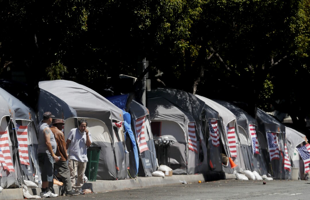 American flags decorate tents at an encampment of homeless veterans in Brentwood.