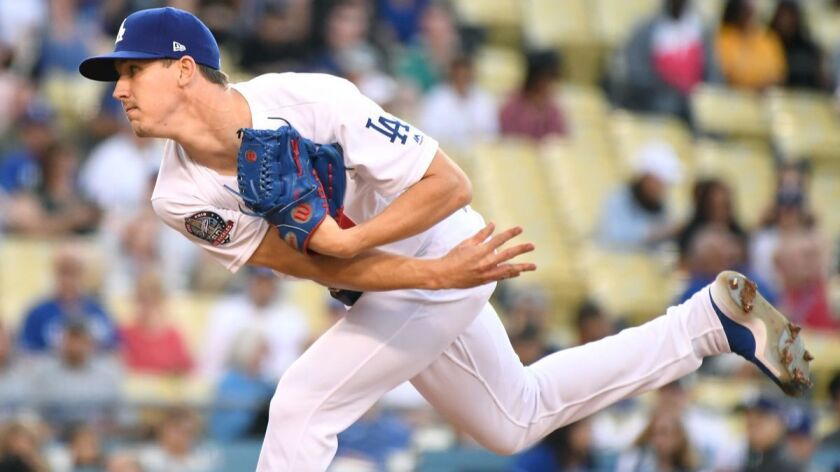 LOS ANGELES, CALIFORNIA JUNE 8, 2018-Dodgers pitcher Walker Buehler throws a pitch against the Brave