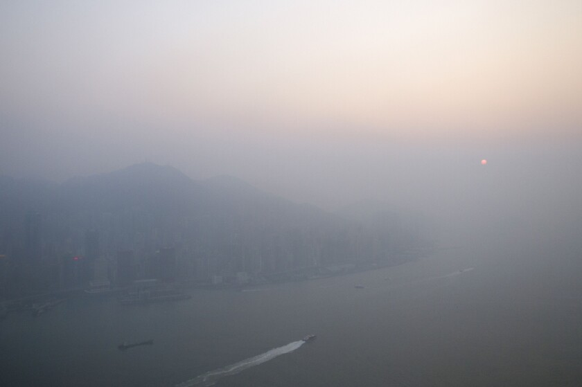A new study finds the ocean surface can remove a key ingredient of smog from the air near coastal cities. Above, the sun sets through pollution hanging over Hong Kong.