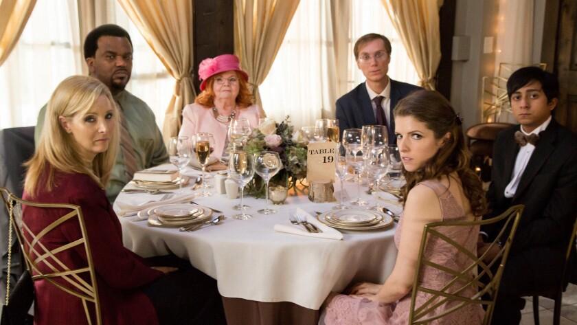 "Lisa Kudrow, left, Craig Robinson, June Squibb, Stephen Merchant, Anna Kendrick and Tony Revolori in ""Table 19."""